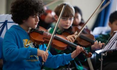 Primary school children making music in Tower Hamlets.